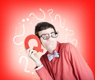 Smart thinking men with q for question mark Stock Image