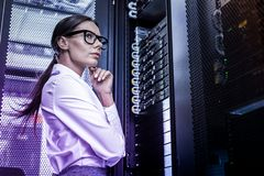 Smart thoughtful woman thinking about cyber crime stock photography