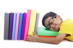 Smart toddler with glasses sleeping with books Royalty Free Stock Photography