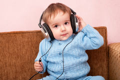 Smart toddler with headphones Stock Image