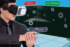 Smart training with augmented and virtual reality technology con. Cept, The policeman or gamer use simulation training with ar and vr to practice with shooting stock photography