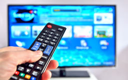 Free Smart Tv And Hand Pressing Remote Control Stock Photo - 45556560