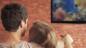 Smart tv and  couple pressing remote control. stock footage