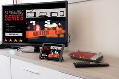 Smart tv and digital tablet connected to internet modem Stock Image