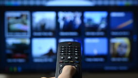 Smart tv and hand pressing remote control. Smart tv with apps and hand stock footage