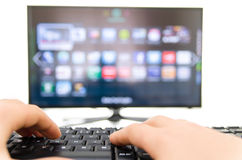 Smart tv and keyboard connect to the internet Stock Image