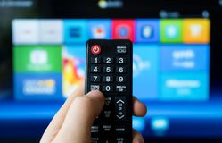 Smart TV. Male hand holding TV remote control. Smart TV Royalty Free Stock Photo