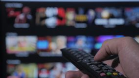 Smart tv. online video streaming service. with apps and hand. Male hand holding remote the control turn off smart tv