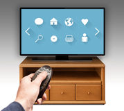 Smart tv UHD 4K controled by remote control. stock images