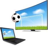 Smart TV y ordenador portátil Foto de archivo