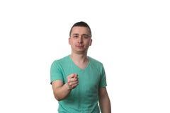Smart ung man som pekar på dig arkivbild
