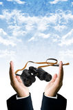 Smart vision concept, Binocular in hand Stock Photo