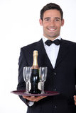 Smart waiter holding tray Stock Photo
