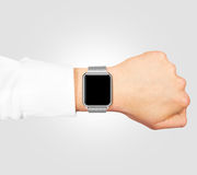 Smart watch blank screen mock up wear on the hand isolated. Smart watch blank screen mock up wear on the hand isolated on gray. Steel metallic hand clock mockup Royalty Free Stock Image