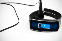Smart watch charging with micro USB cable. Stock Photography