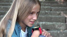 Smart Watch, Child Using Smartwatch Outdoor in Park, Kid Talking at Smartphone