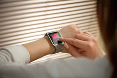 Smart watch on a female hand Royalty Free Stock Images