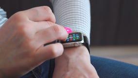 Smart watch on the girl`s hand. Girl uses wrist smart watch