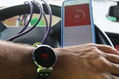 Smart watch. Smartphone. Skipping rope. A smart watch with heartbeats indicator Stock Images