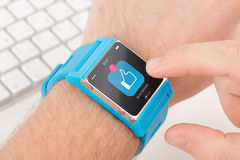 Smart watch on male hand with like icon Royalty Free Stock Photo