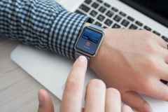 Smart watch in man hand with touch and pay Royalty Free Stock Photo