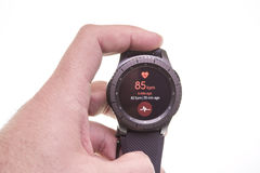 Smart watch measuring heart rate. Heart rate monitor on smart watch display Royalty Free Stock Photo