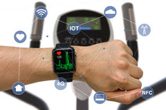 Smart Watch Monitoring Heart Rate Application Concept While Exercising with Elliptical Machine royalty free stock photo