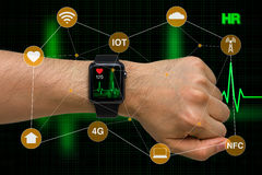 Smart Watch Monitoring Heart Rate Application Concept with Heart. Concept of smart watch monitoring heart rate application with heart beat cardiogram stock image