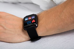 Smart Watch Showing Heartbeat Rate. On Man `s Hand Royalty Free Stock Photo