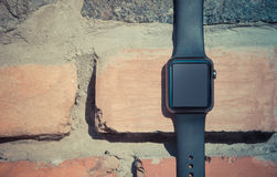 Smart watch on stone background. Mockup template Royalty Free Stock Photo