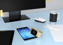 Smart watch synchronized with smart phone. Smart watch synchronizing fitness app with smart phone on table Stock Images