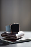 Smart watch, wallet with monet, passport on the table Royalty Free Stock Photography