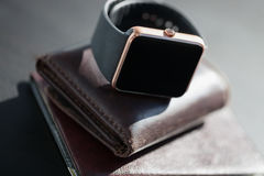 Smart watch, wallet with monet, passport on the table Stock Photo