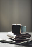 Smart watch, wallet with monet, passport on the table Royalty Free Stock Image