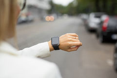 Smart watch on womans wrist Royalty Free Stock Images