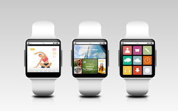 Smart watches with applications on screens Royalty Free Stock Photos