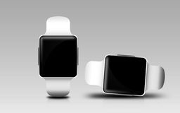 Smart watches with black blank screen over gray Stock Photography