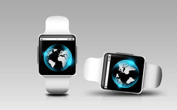 Smart watches with earth globe on screen Stock Photography