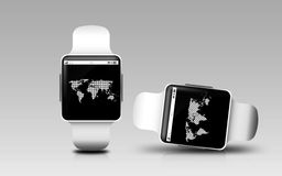 Smart watches with earth globe on screen Stock Image