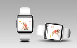 Smart watches with fitness app on screen Royalty Free Stock Image