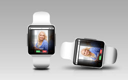 Smart watches with incoming call on screen. Modern technology, communication, object, responsive design and media concept - smart watches with incoming call on royalty free stock photography