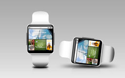 Smart watches with internet news on screen Stock Photo