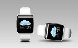 Smart watches with weather forecast on screen Stock Image