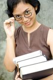 Smart woman with books on hands royalty free stock photography