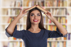 Smart woman with books Royalty Free Stock Image