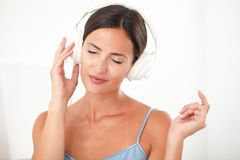Smart woman chilling out by listening to music Royalty Free Stock Photography