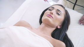 Smart woman getting ultrasonic face procedure in beauty spa stock video