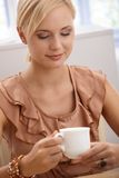 Smart woman having coffee Royalty Free Stock Image