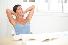 Smart woman looking satisfied and relaxed Royalty Free Stock Images