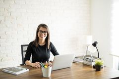 Smart woman at the office Stock Images